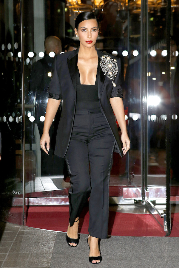 Kim Kardashian dons plunging Givenchy outfit on way to Carine Roitfeld party **USA ONLY**