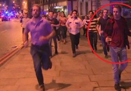 68172050_in-this-image-taken-from-video-footage-people-run-from-the-scene-of-attack-alongside-a-man-(2)2